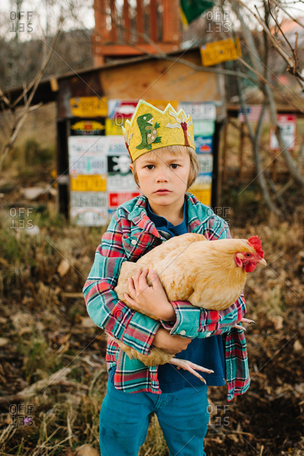 Portrait of a young boy with a chicken
