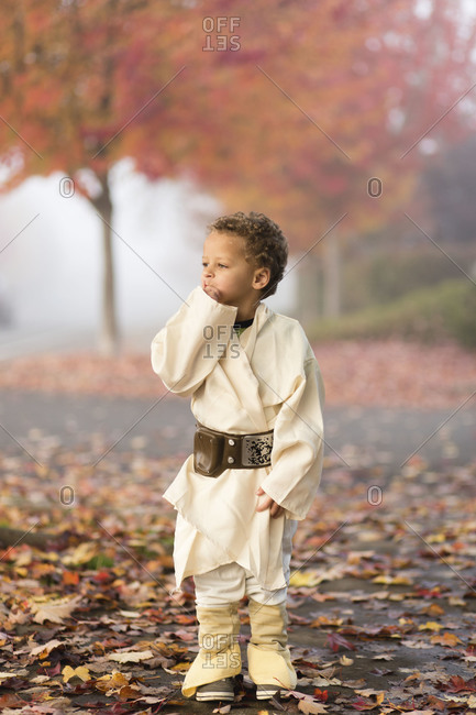 Boy in Halloween costume in street