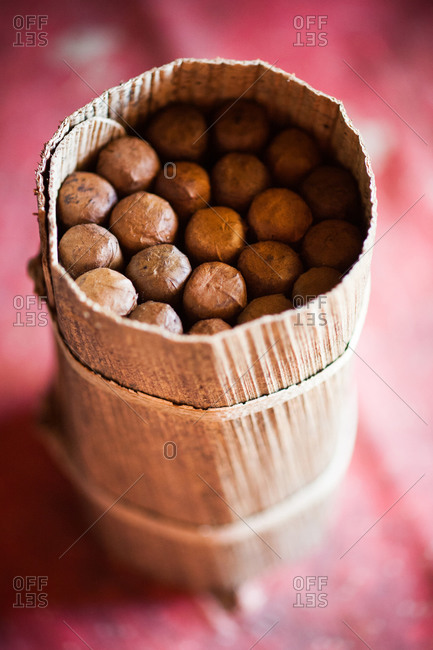 A finished packet of cigars stands on a table in the Vinales valley in Cuba Cigars are wrapped in banana leaves to keep the cigars from getting too dry