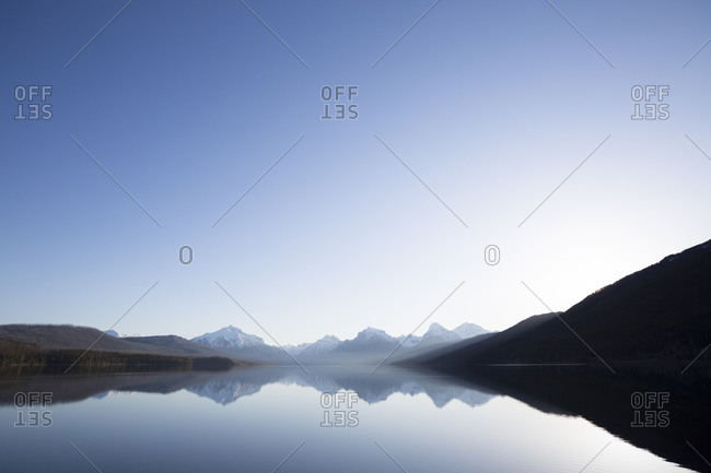 A calm morning before sunrise on Lake McDonald in Glacier National Park