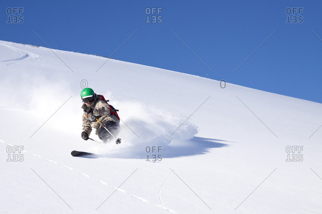 A male skier skiing at Big Sky Resort in Big Sky, Montana