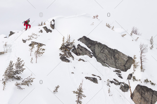 A male backcountry skier boot packs up a ridge to ski in the Beehive Basin near Big Sky, Montana