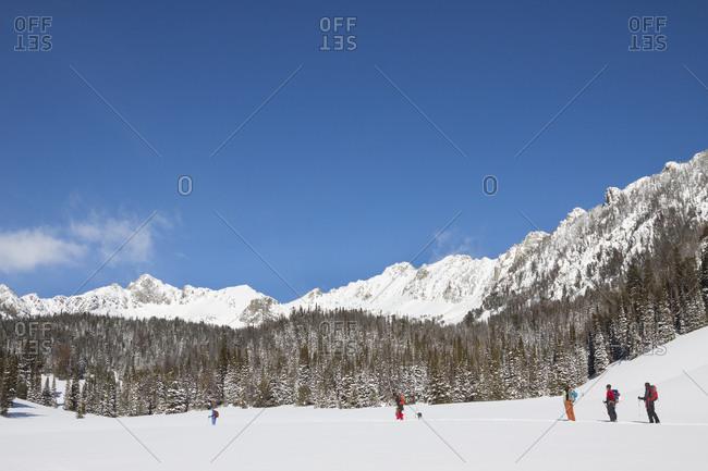 A group of five backcountry skiers ski in the Beehive Basin near Big Sky, Montana
