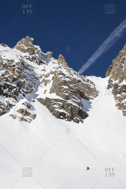 A backcountry skier turns in the Fourth of July�Couloir in the Beehive Basin near Big Sky, Montana