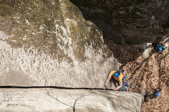 Man climbing a crack route in Cadarese, one of the main places in Europe for trad and crack climbing Premia, Ossola, Italy