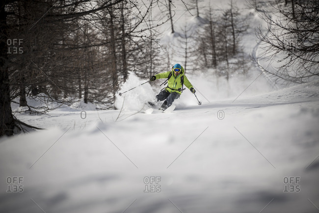 A backcountry skier descends a steep slope in Devero, Ossola, Italy