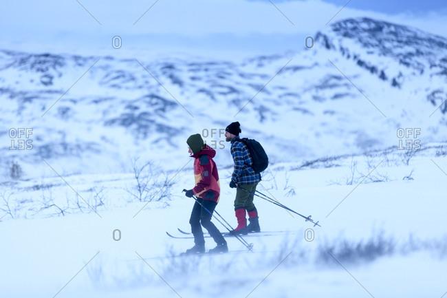 Two people skiing