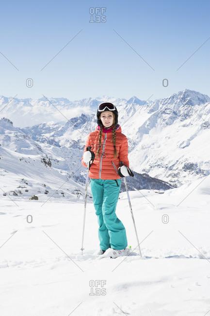 Young woman wearing skiwear looking