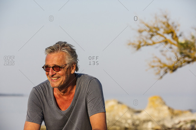 Smiling mature man looking away