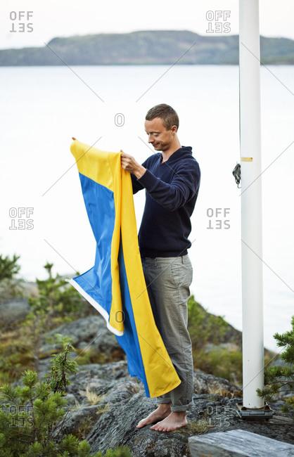 Man holding Swedish flag