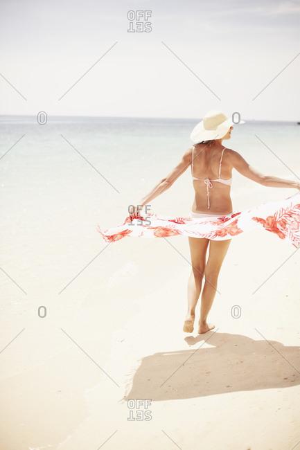 Woman with sarong on beach