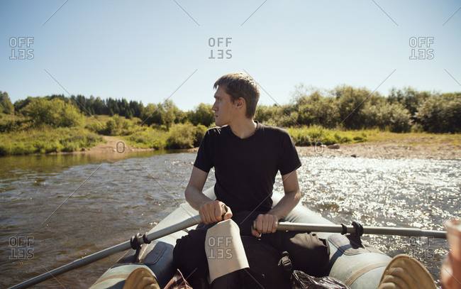 Man in rowboat on river in Oregon
