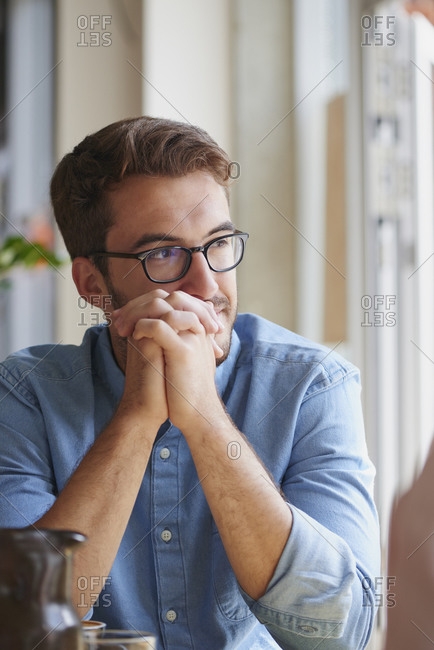 Man in coffee shop staring off