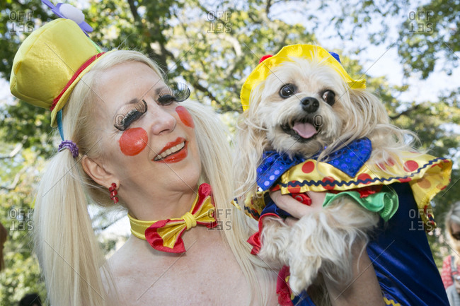 October 25, 2014 - New York: Dog and owner in matching clown costumes at the 24th annual Tompkins Square Halloween Dog Parade