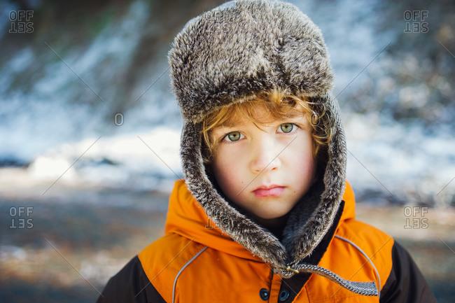 Portrait of boy in bomber hat in winter