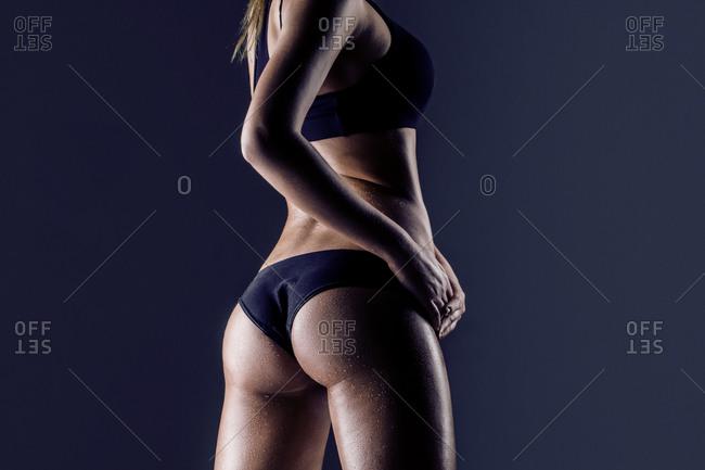Woman wearing black panties and bra
