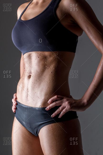 Woman wearing black underwear against black background