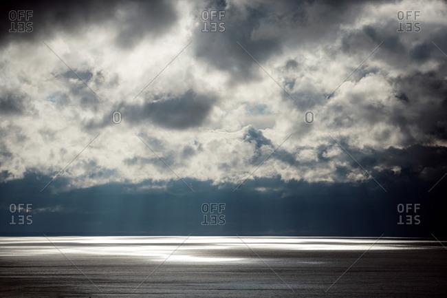 Sun rays on silvery sea