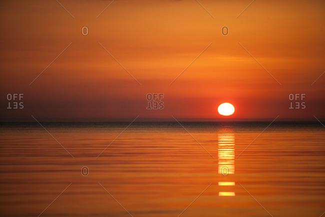 Setting sun glowing orange