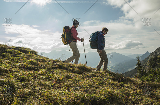 Young couple hiking on alpine meadow, Tyrol