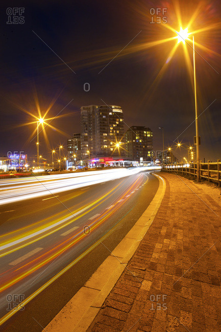 Light trails at busy street by night, Cape Town