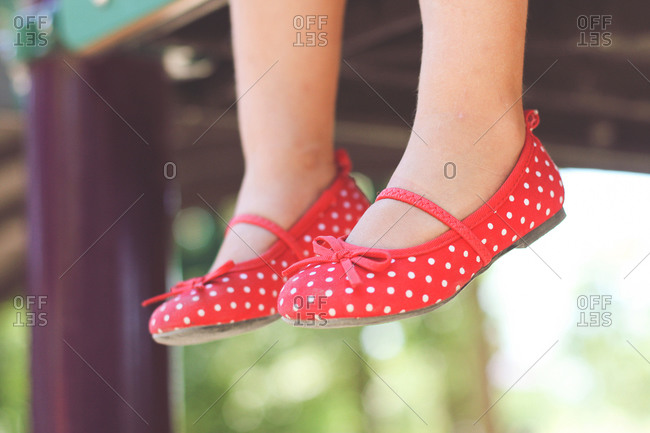 Close up of girl dangling her feet