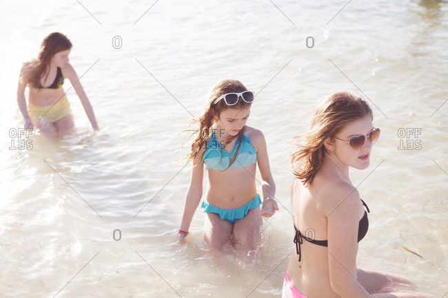 Young girls standing in a lake