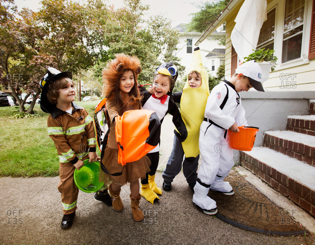 Group of kids outside house on Halloween