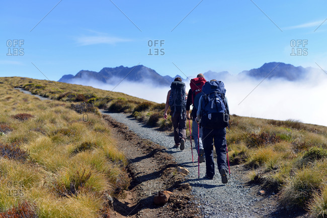 People hiking on a mountain trail
