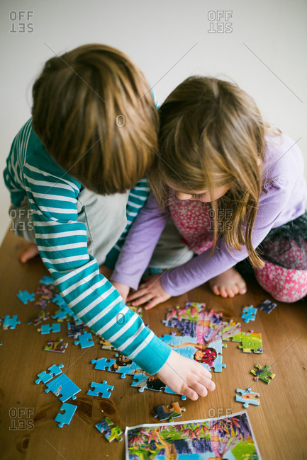 Kids playing with jigsaw