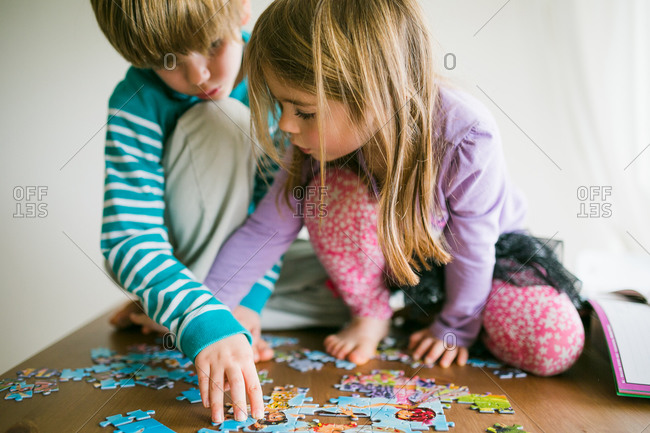 Children putting a jigsaw puzzle together