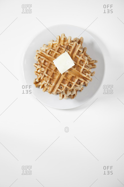 Stack of waffles with butter