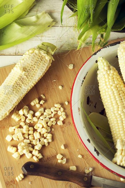 Shelled corn cob on a cutting board