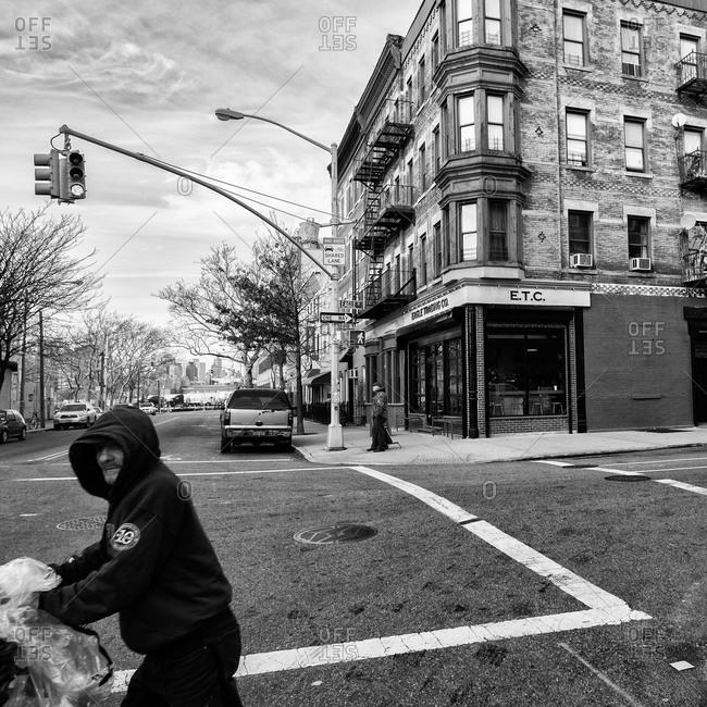 Brooklyn, New York - December 24, 2012: Hobo crossing the street in Greenpoint
