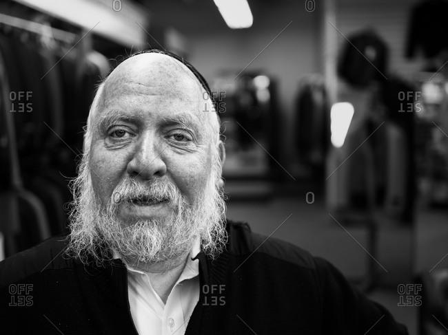 New York, New York - December 25, 2012: Portrait of a shopkeeper in his Manhattan store