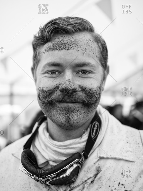 Chichester, United Kingdom - September 14, 2013: Portrait of man covered in dirt attending the 2013 Goodwood Revival