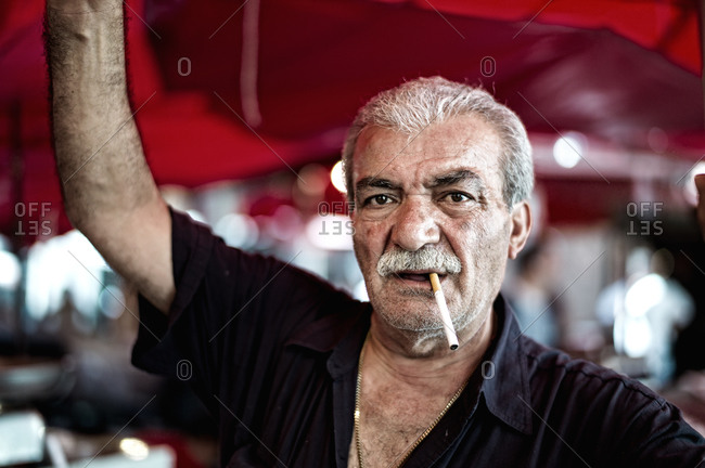 Sicily, Italy - September 6, 2011: Portrait of a fisherman at a market