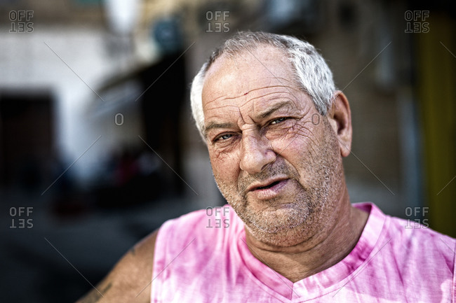 Sicily, Italy - September 13, 2011: Portrait of a grey haired man in Sicily