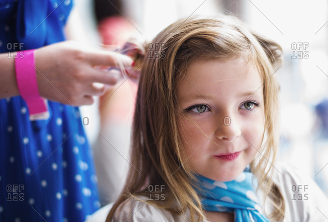 Glasgow, Scotland - July 27, 2013: Blonde young girl at a hairdresser getting a vintage hair do
