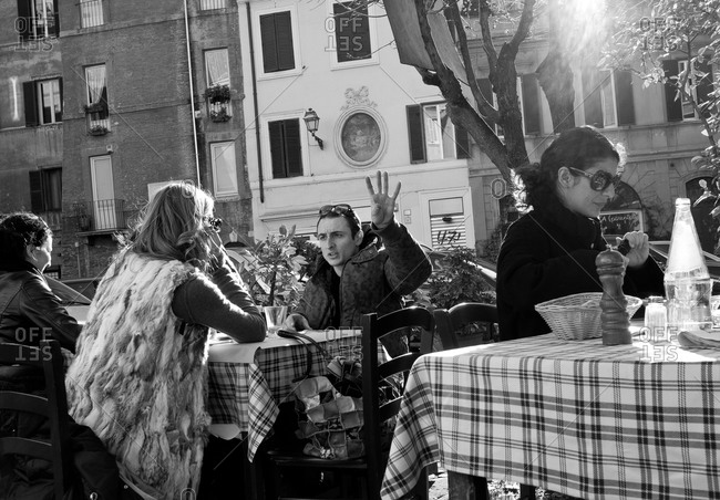 Rome, Italy - February 7, 2010: People at the sidewalk tables of a restaurant
