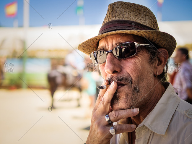 Andalusia, Spain - May 3, 2014: Headshot of a smoking man