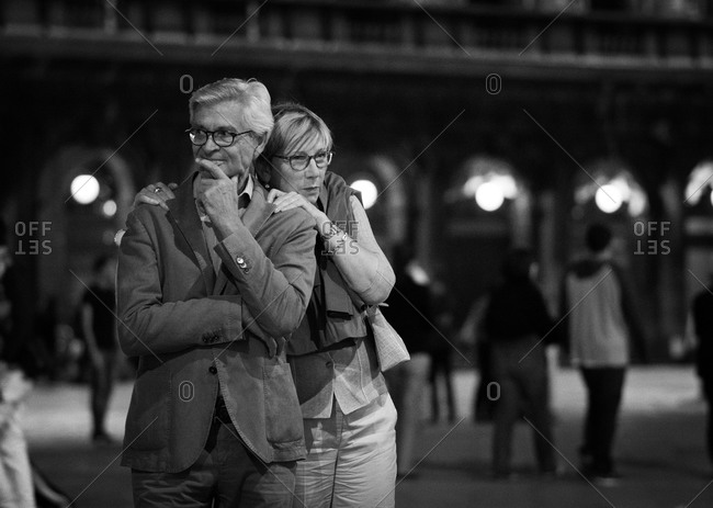 Venice, Italy - June 5, 2014: Elderly couple watching the crowd on a street