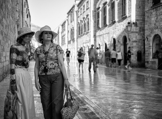 Dubrovnik, Croatia - June 16, 2012: Women gossiping in a street