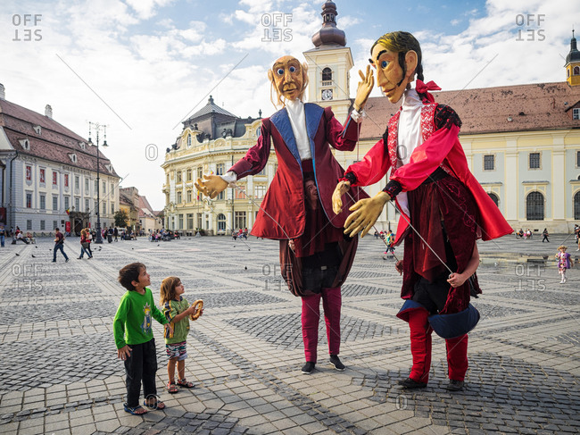 Sibiu, Romania - September 5, 2014: Street entertainers with children in an old square