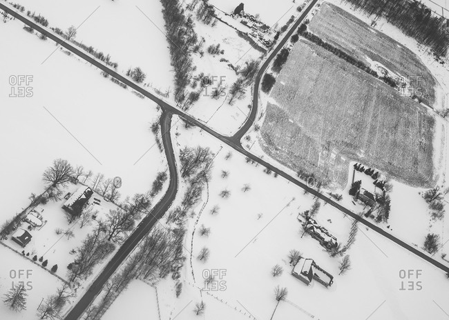 Aerial view of village covered in snow