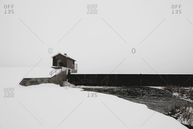 Small house by a dam