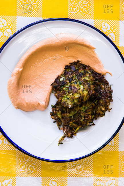 Zucchini fritters with sauce on plate