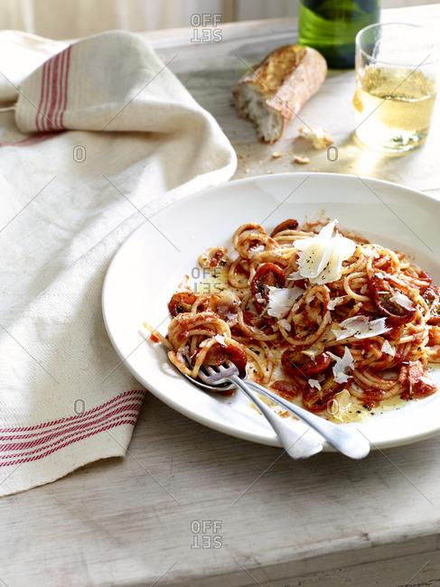 A plate of partially eaten spaghetti