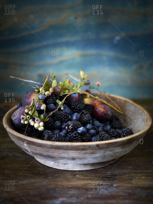 Various berries and figs in bowl