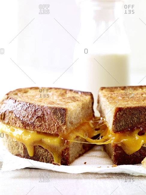 Grilled cheese sandwich halves being pulled apart